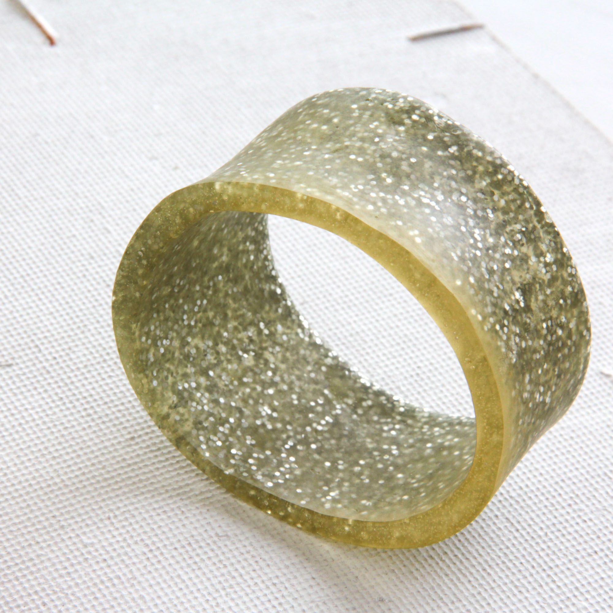 glitter resin bangle - • handcasted• transparent plus full of glitter fun• bold, chunky and chic• br345 euro