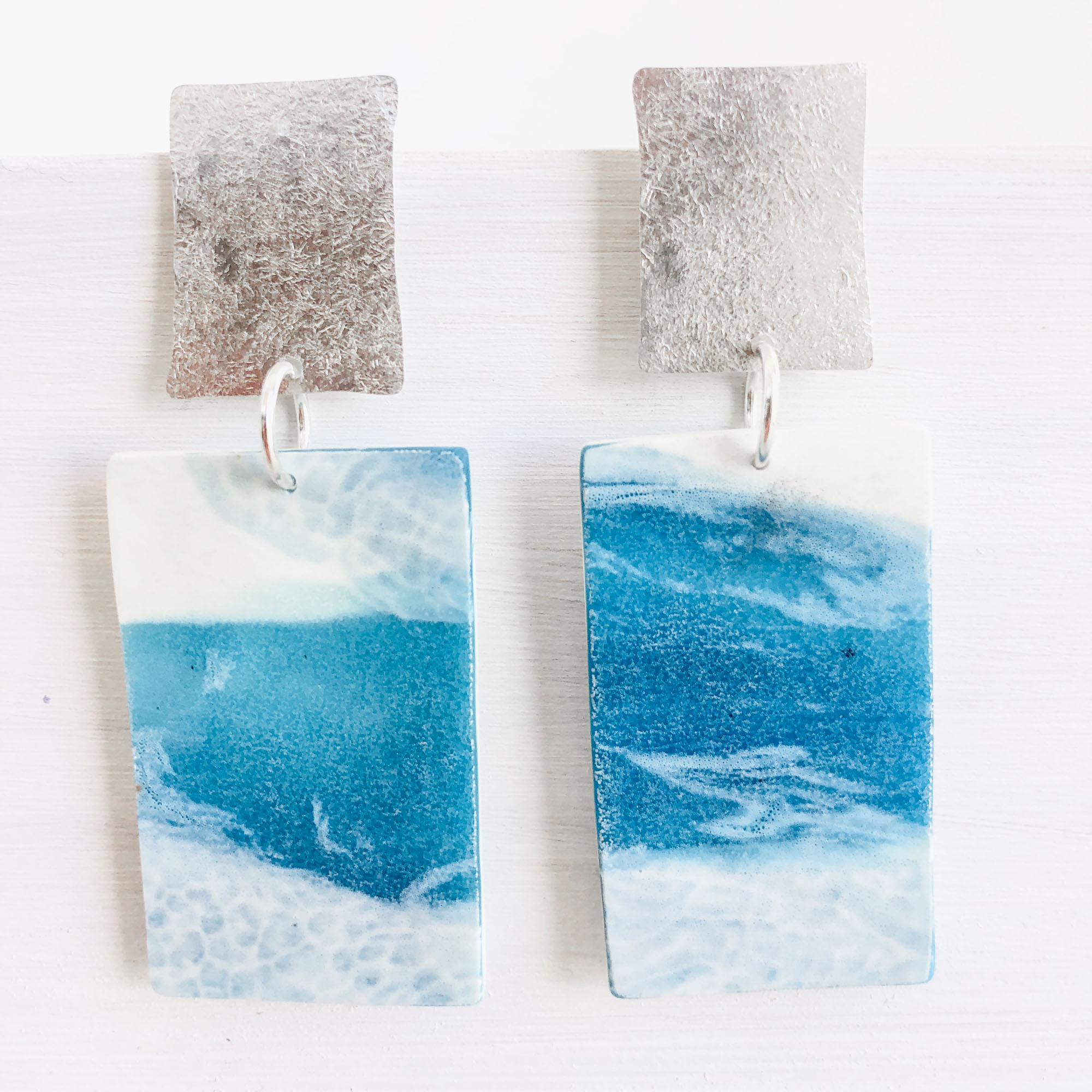 light and bright  resin earrings - • ocean colours • matt finish• drop length approx. 7 am• resin • hammered sterling silver• red2• 70 euro