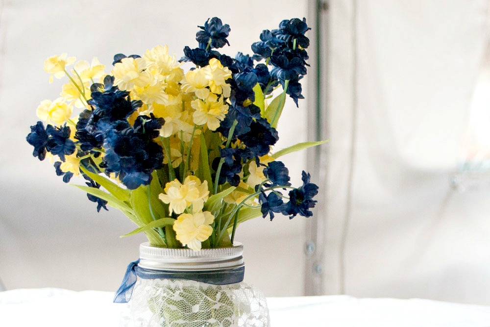 Floral arrangement yellow and blue Carnations