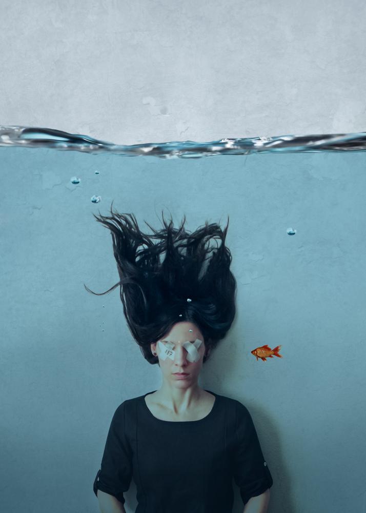 Lauren Midgley is a Conceptual Fine Art Portrait Photographer based in Norman, OK