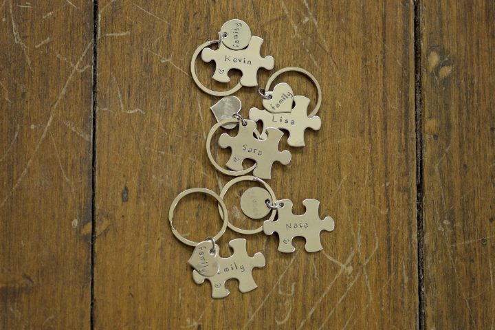 This couple decided to give puzzle piece key chains to their kids during the ceremony to commemorate them coming together as a new family.