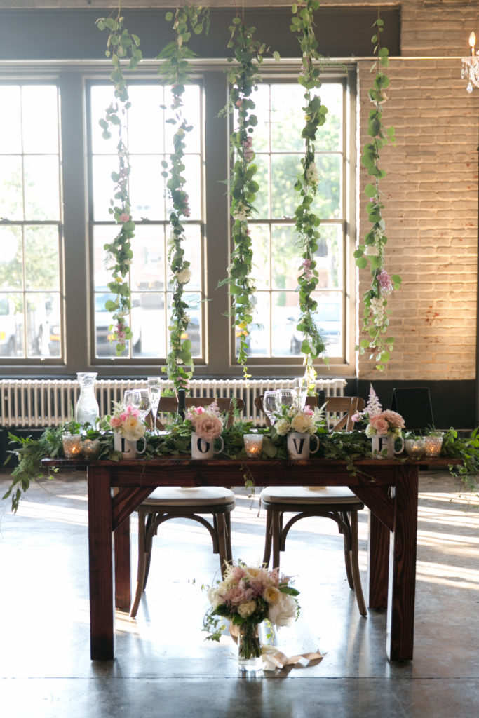 This bride bought their farmhouse sweetheart table as a gift to her groom!