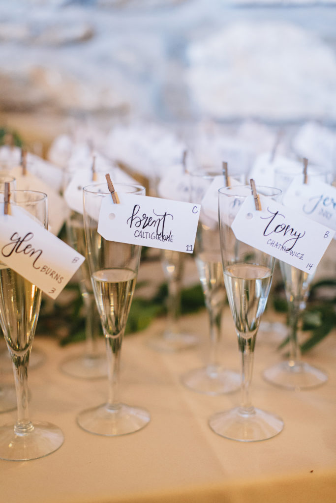 Champagne glass escort cards.