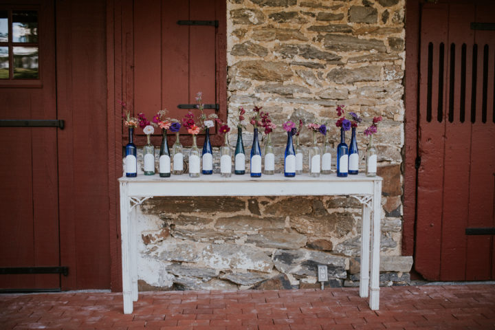 """This bride decided to do her seating """"chart"""" on bottles."""