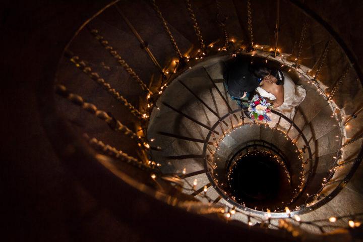 This couple got married in a castle. Love this photo in the spiral staircase!