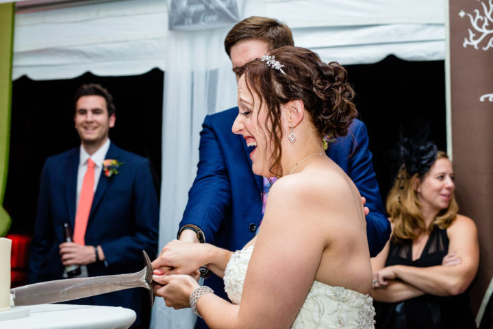 Yes…this couple cut their cake with a SWORD!!