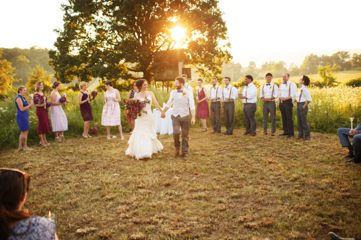 They were able to have the ceremony in the field like they wanted. After rehearsal the night before, they had someone come out and mow the area for the ceremony. The treehouse the bride used to play in was in the background. This was very special to her. Photo by The Wiebners.
