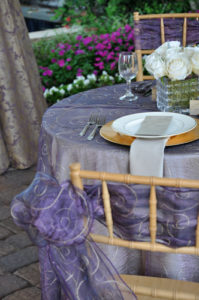 You could add a specialty linen to just your sweetheart table to add a little elegance and to really make your table stand out