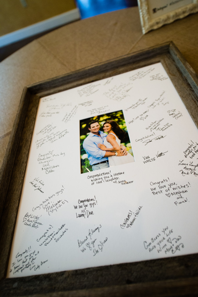 Guests all signed their well wishes on this photo mat that was around one of their engagement pictures.