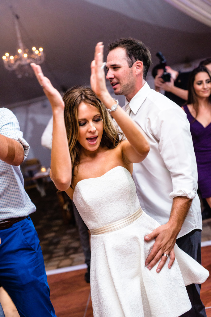 Kristen changed was her wedding dress into a reception dress which was much cooler so she could dance the night away!
