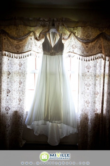 Empire style dress - note the seaming under the bust area and then the dress flows from there. Photo by Miville Photo.