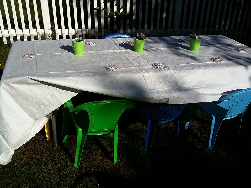 We used a table cloth on the kids table that could be colored on and put crayons in cups for them.