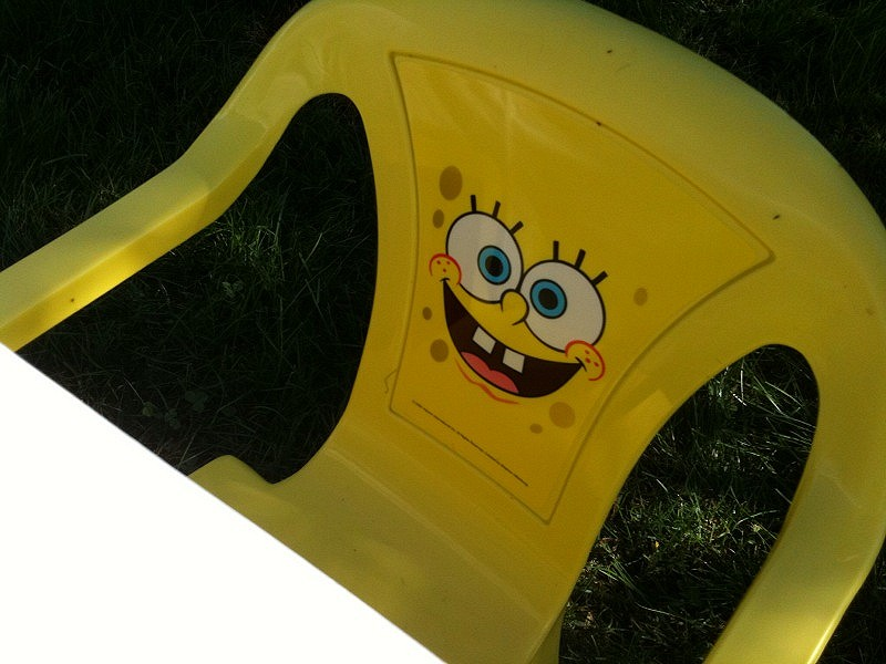 The kids chairs each had a different cartoon character on them.