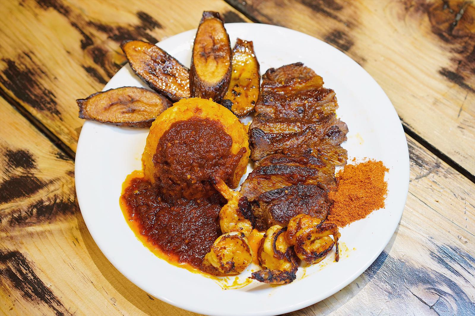 Suya Surf & Turf - A delicious Nigerian dish of suya spiced rump steak, suya grilled prawns, asaro, eaw agoyin sauce, pottage and fried plantain
