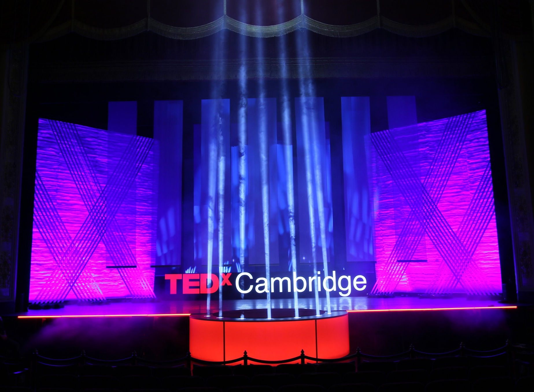 TEDxCambridge - TEDxCambridge 2018 represented our fifth collaboration with Port Lighting, who provided lighting design for our 2,500 guests at the Boston Opera House.This year's show featured a new stage element that Port Lighting collaboratively designed from the initial idea and product testing, through to fabrication review and on-site venue setup.The result was a semi-circular lightbox featuring LED luminaries and moving head uplights that created a dramatic theatrical effect for the event production. It's a pleasure working with such a talented group of creative lighting professionals who share our passion for excellence.Dmitri GunnExecutive Director