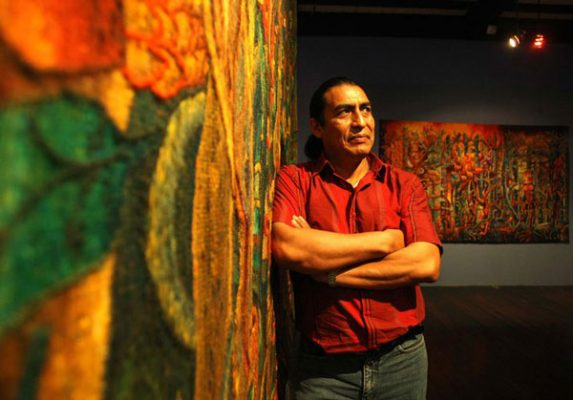 Maximo-Laura-with-his-tapestries-573x400.jpg