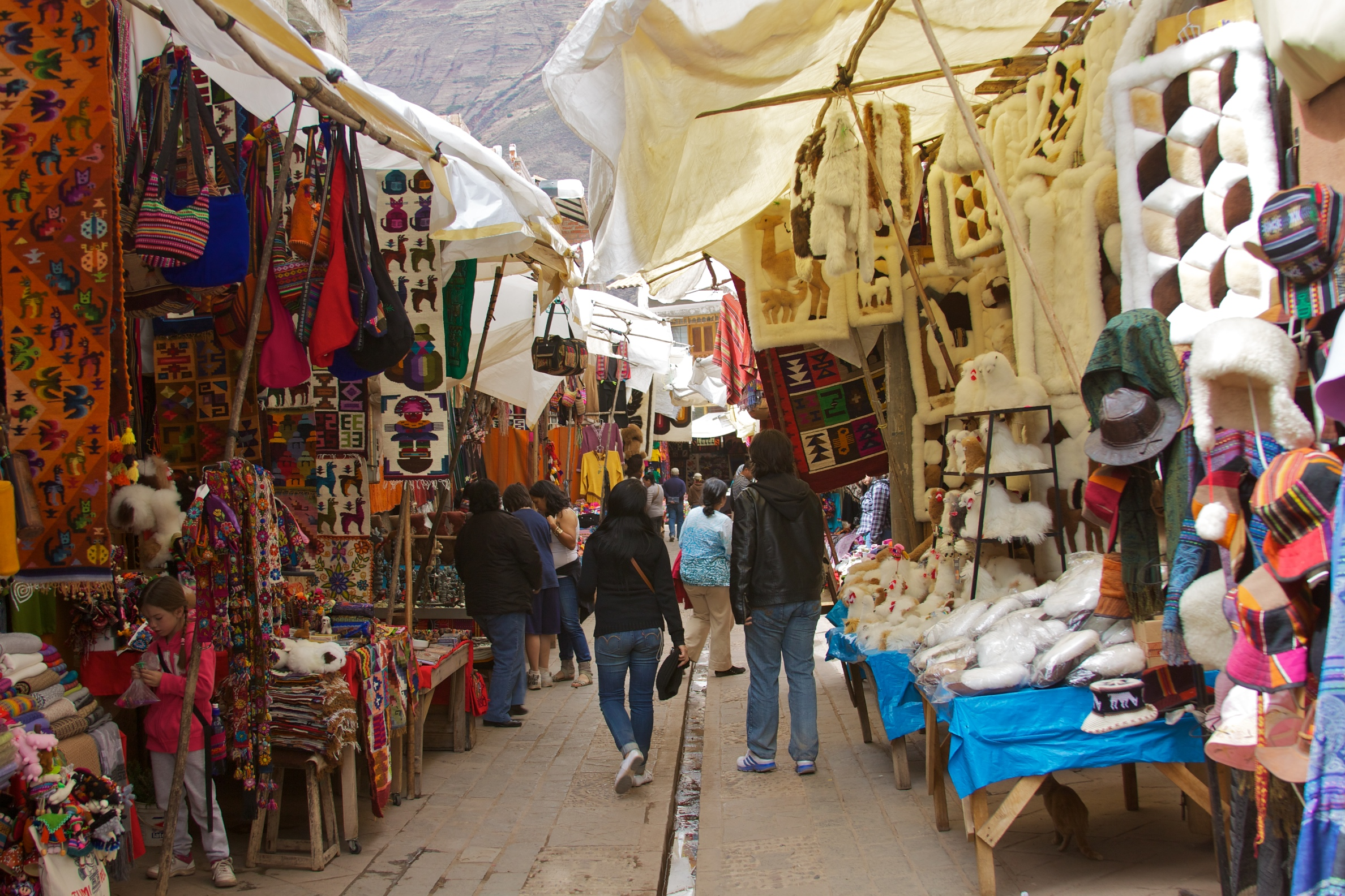See, touch and feel at Pisac market - The sleepy town of Pisac comes alive every Sunday when people from the surrounding communities come together to sell and buy produce, crafts and more.