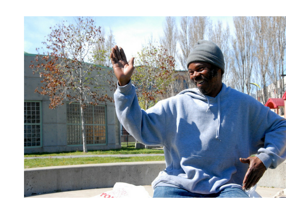 "Ramon - Ramon is originally from California's Central Valley, but he's been homeless in San Francisco for a little over a year. He has a seven year old son in Australia and a 21-year old son who lives locally. Ramon says he wants to change his life for his sons and that SOS is helping him do that by providing him with free medical care and hygiene supplies each week. Nowhere else has he been that ""people show up and ask what you need and then they give it to you."" ""SOS keeps me going,"" he says. ""It's very cool."" (Photo credit: Marlena Hartman-Filson)"