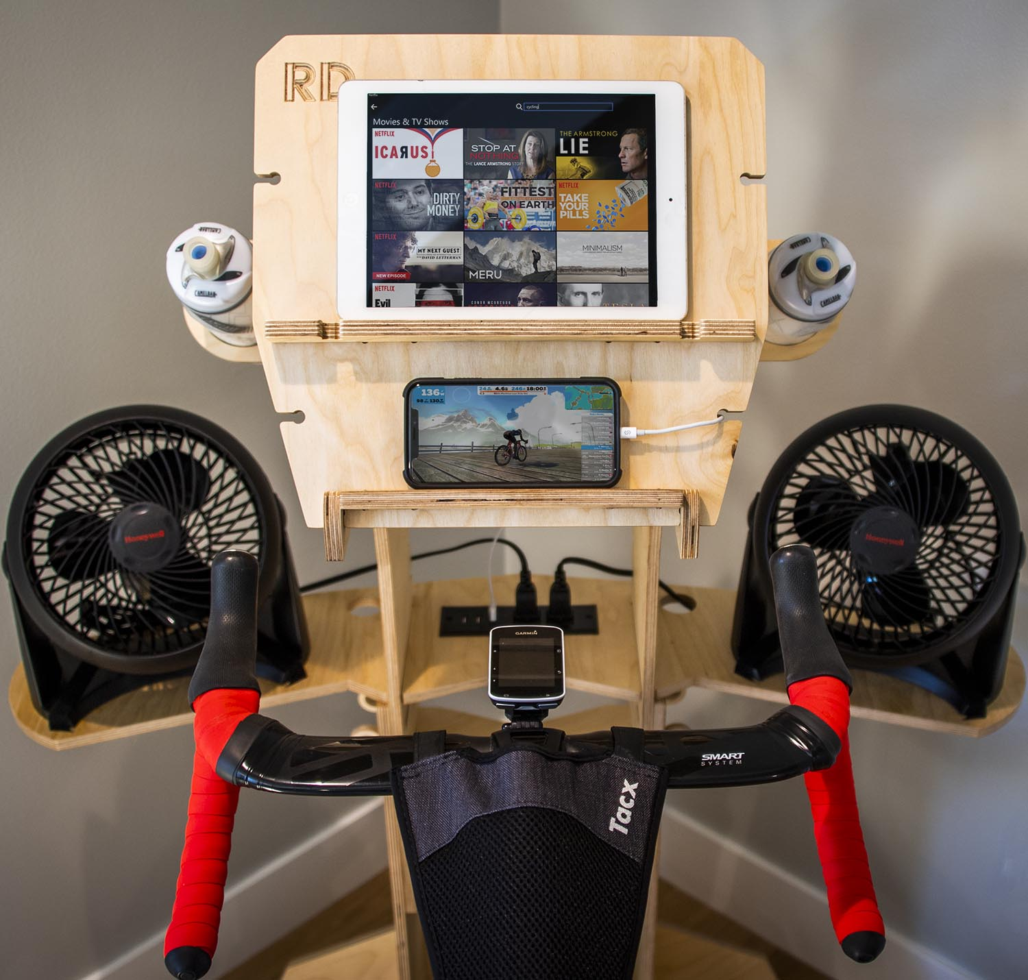 Tablet/Phone Shelf - Phone/TabletRun Zwift, TrainerRoad or any other e-trainer app from your phone while you watch a movie on your tablet. Keep both devices powered up with our integrated USB sockets