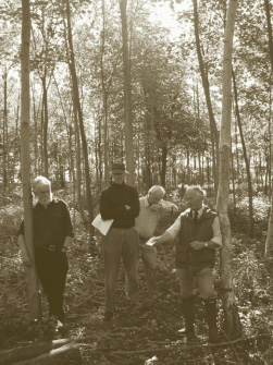 Dr Sam Samuels (left), Norman Weiss, Bede Howell and Andrew Woods discussing thinning in a young Ash stand at Parlington
