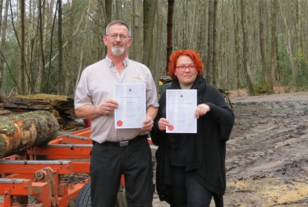 David Biggs, General Manager, Wood-Mizer UK and Liza Niedduof Artizans of Wood with their certificates of membership of Woodland Heritage