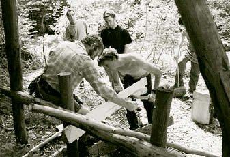 Mike Abbott (left) helps Steve split a green oak billet.