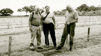 2001 - American Walnut Council experts, Bob Burke and Dr. Larry Severeid, with Robin Bircham of WTC (right) inspecting Bill's new planting.