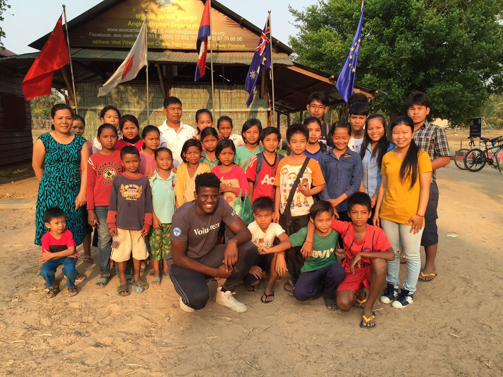 group of people in asia with volunteer