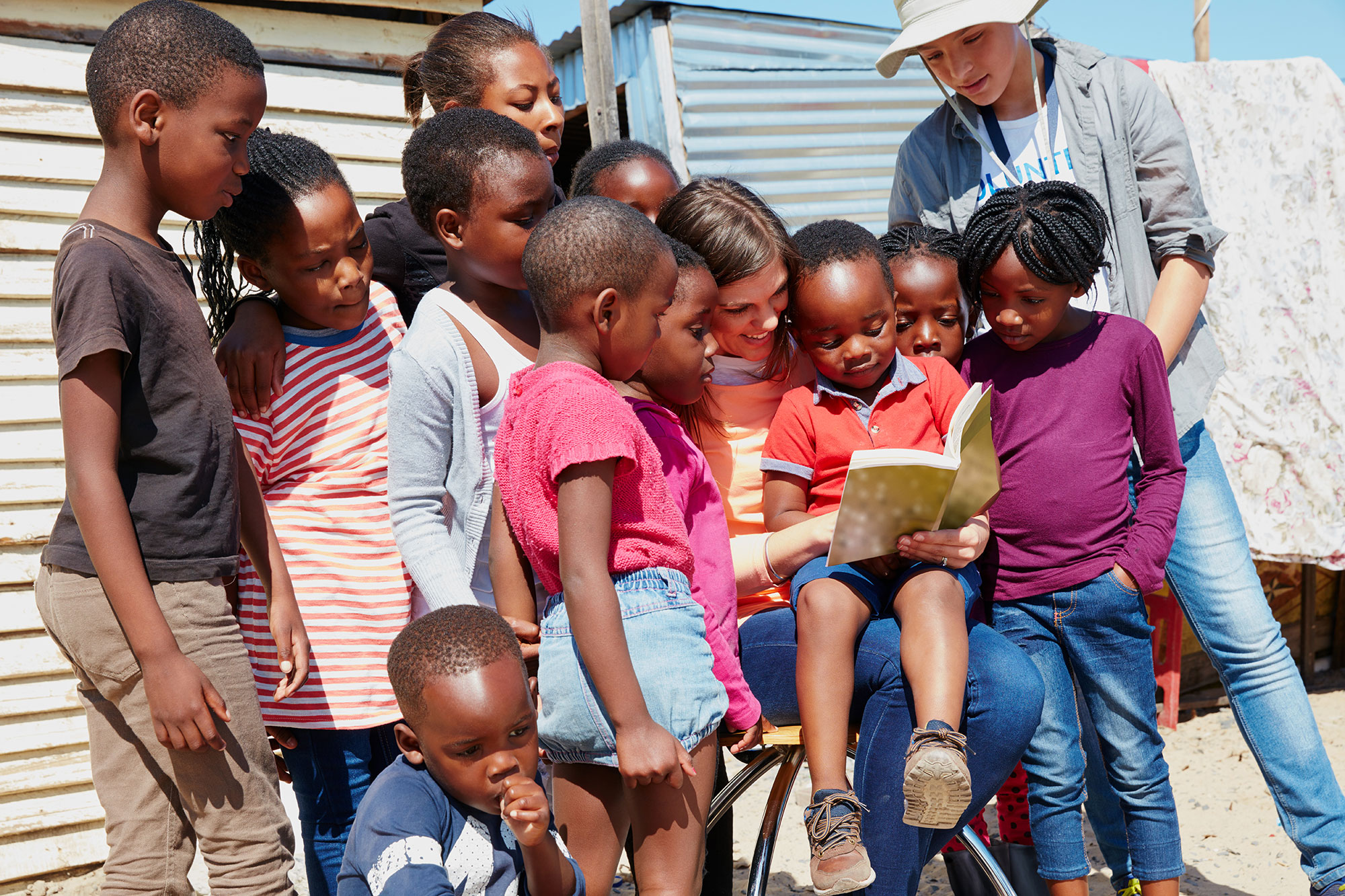 missionary reading book to group of kids africa mission travel