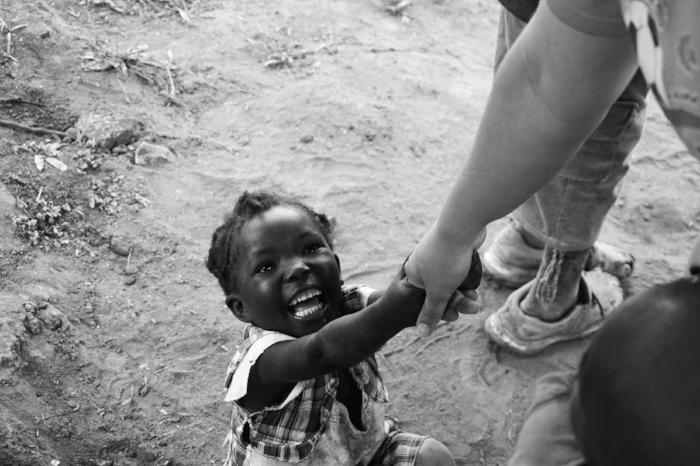 SmilingAfricanBabyholdinghandMissionTraveltwenty20_ec5daafe-5f03-43c7-8217-fe1636e9bf94.jpg