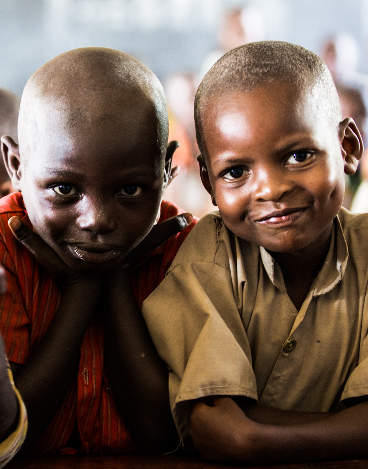 two-boys-at-mitonto-primary-school-in-burundi-the-one-at-right-wearing-the-school-uniform-by-to-led_t20_R7RXkJ.jpg