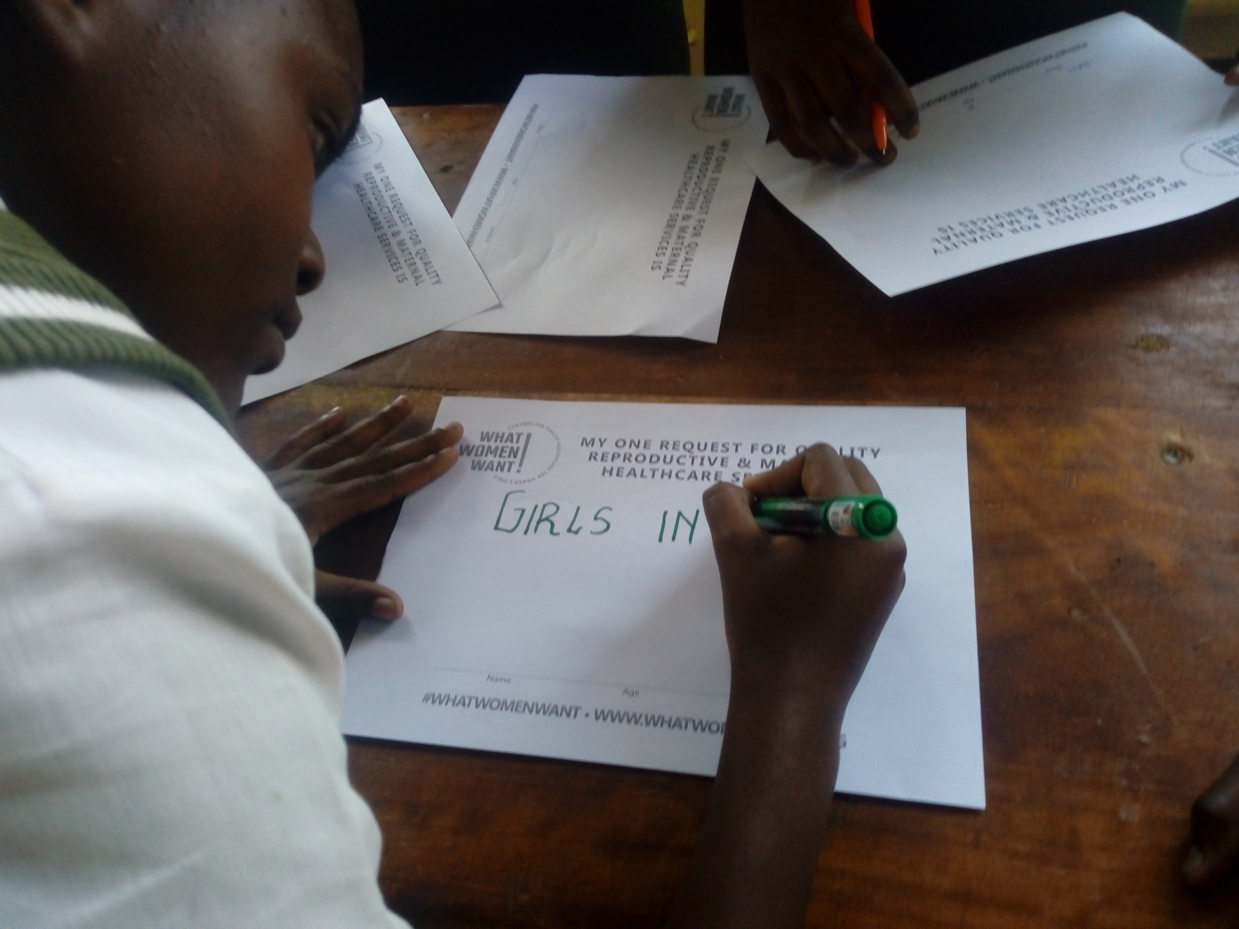 Mobilization_Kenya_WRA Kenya_girl taking survey.jpg