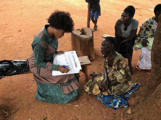 Mobilization_Uganda_Faridah surveying women in rural Uganda.jpeg