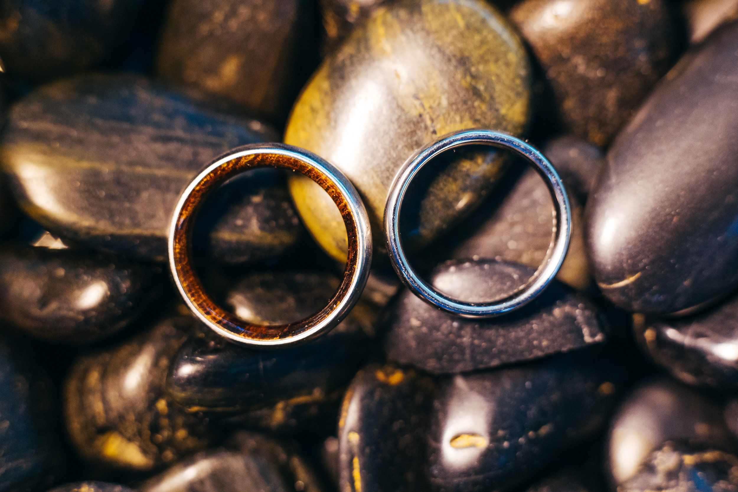 For this photo of Chad and Eddies rings, we wanted to emphasize the natural style of the ring design. There were wood inlays inside the bands, which we thought was absolutely gorgeous. By placing ita gainst some rocks and then lighting it from around the rings, we were able to get the highlights on the rings, and then keep in theme with the natural feel.