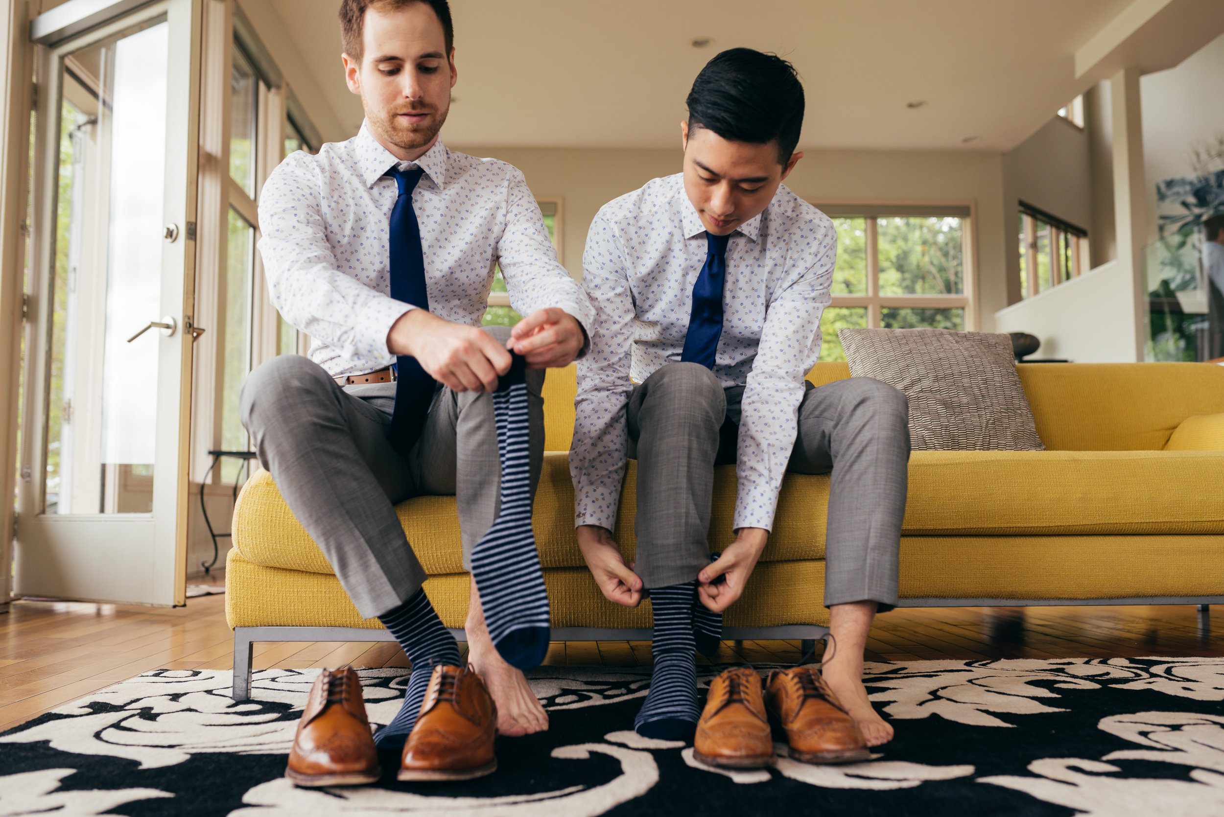 Chad and Eddie getting their socks on together. I loved the striped pattern in the socks.