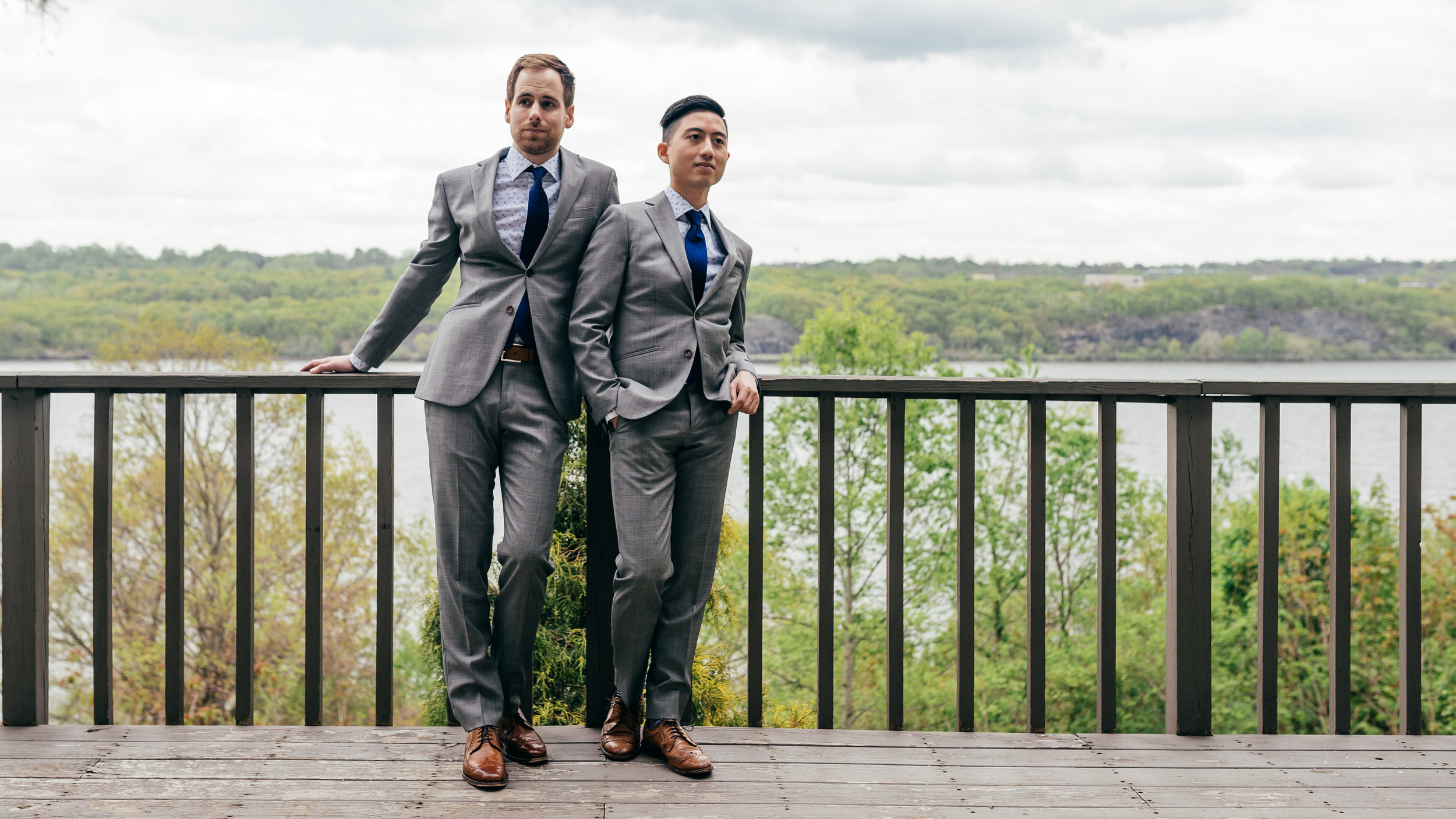 Chad and Eddie helping each other get their suits on and making sure they both look perfect for their wedding ceremony in the Hudson Valley at Buttermilk Falls Inn.