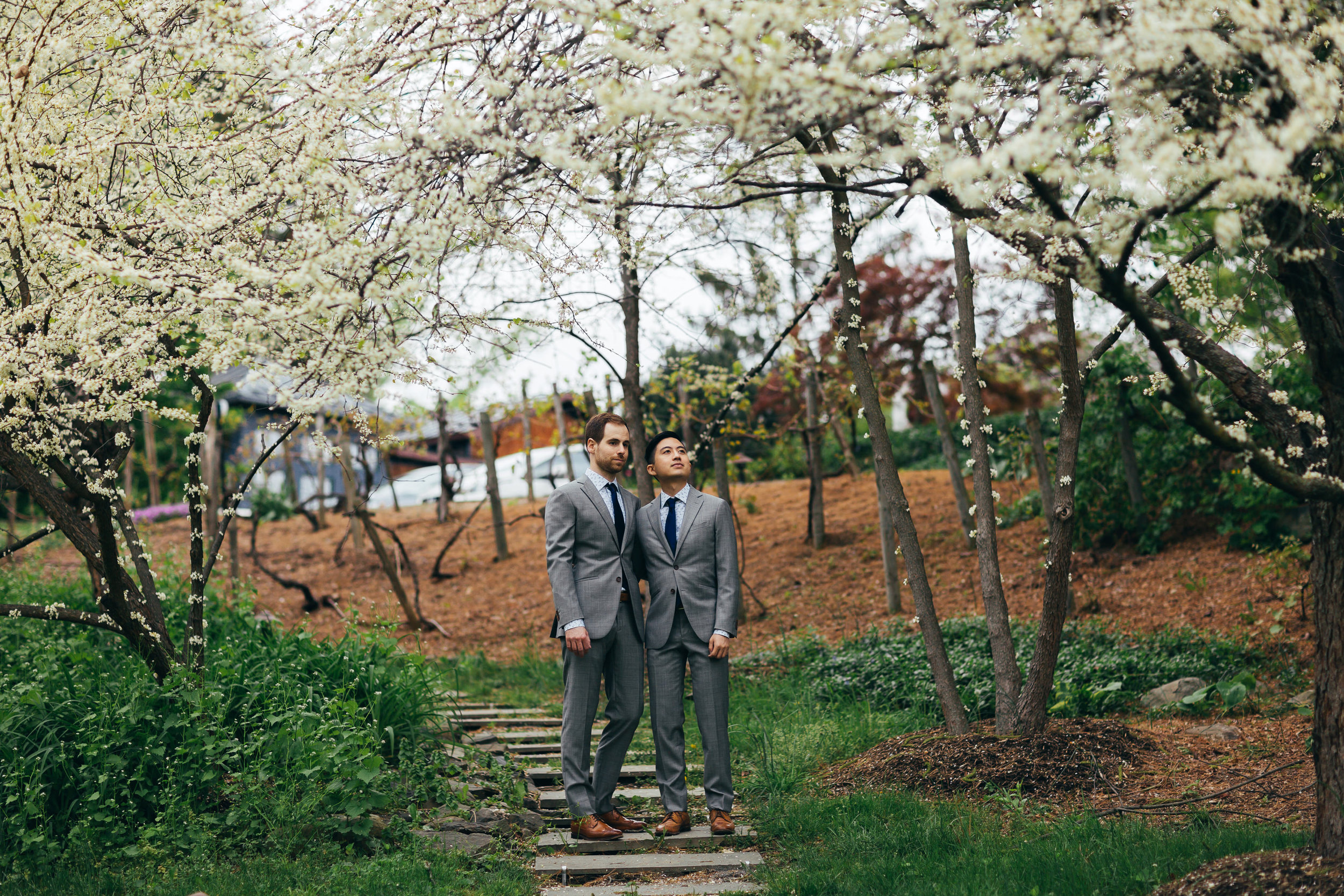 A beautiful aspect of their wedding in the Hudson River valley was that there were all these cherry blossoms in bloom around the property, which just added a wonderful spring feel to all of Chad and Eddies photos. As you can see from this photo, we made sure they had some time to walk around the property and enjoy themselves, as they got ready for their same sex wedding.