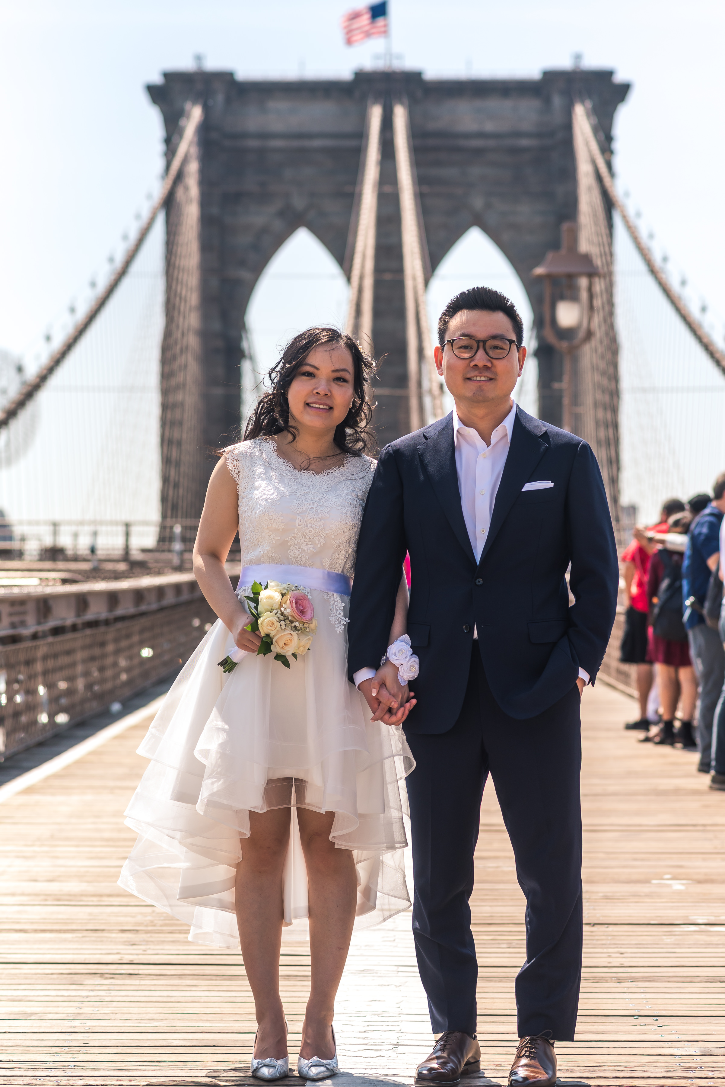 many and andy had a low key ceremony at city hall in manhattan, new york. Part of being a photojournalistic photographer is being able to set up natural looking photos that tell the story of their day. after the ceremony, we took some photos in the area as well as on the Brookyln Bridge
