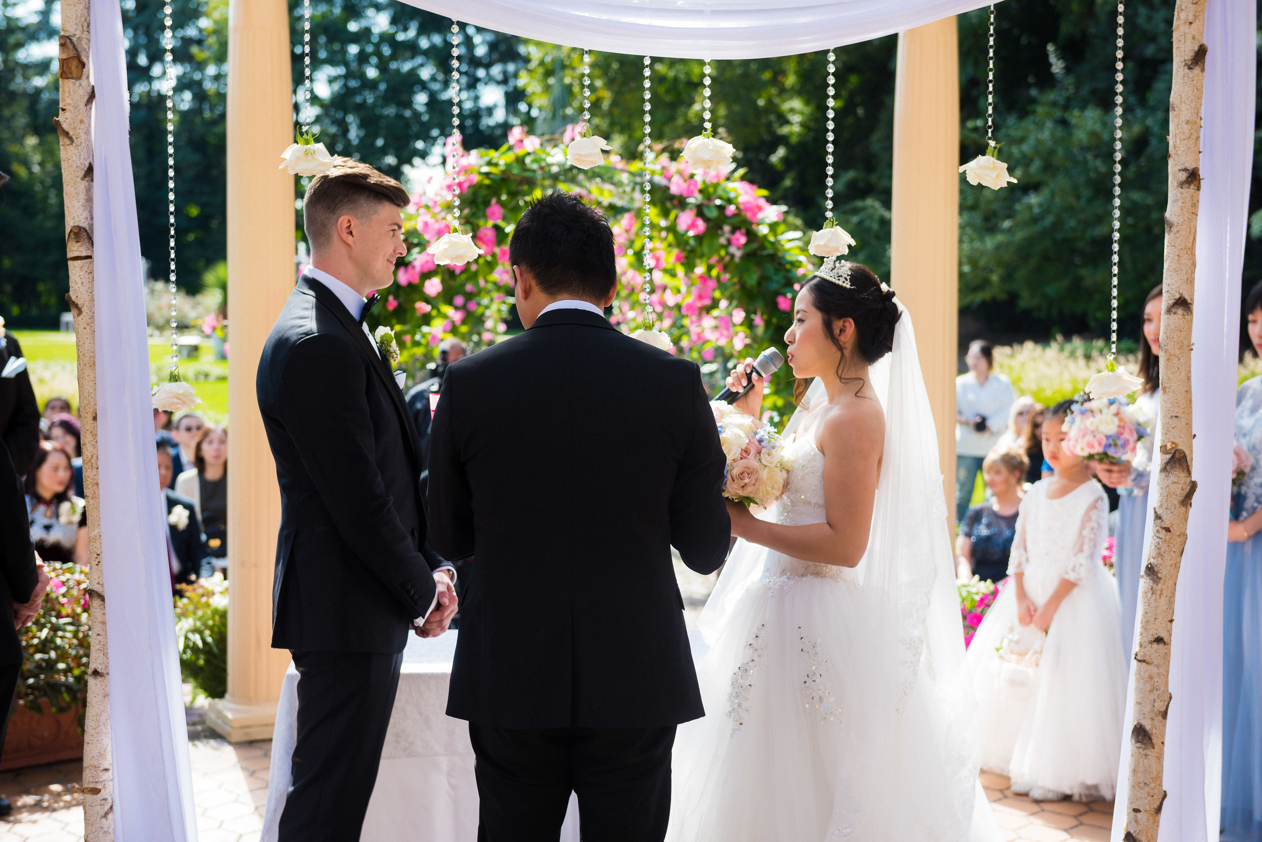 ping and brent both had their own vows during their ceremony. i like the view from behind because you get to see their friends and family in the background watch this new jersey wedding in west orange at the manor.