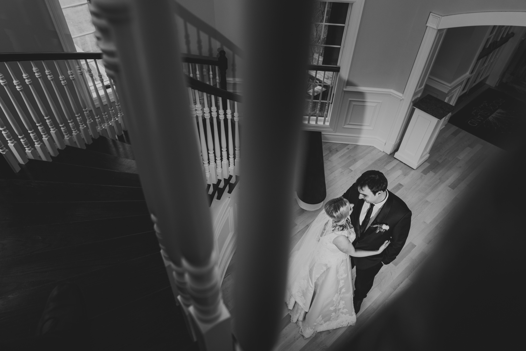 Incorporating compositional tools is another way I can help my images stand out from the crowd, rather than just a straight shot, I used the banister to help me frame Tara and Zach, to draw attention to them in the room.