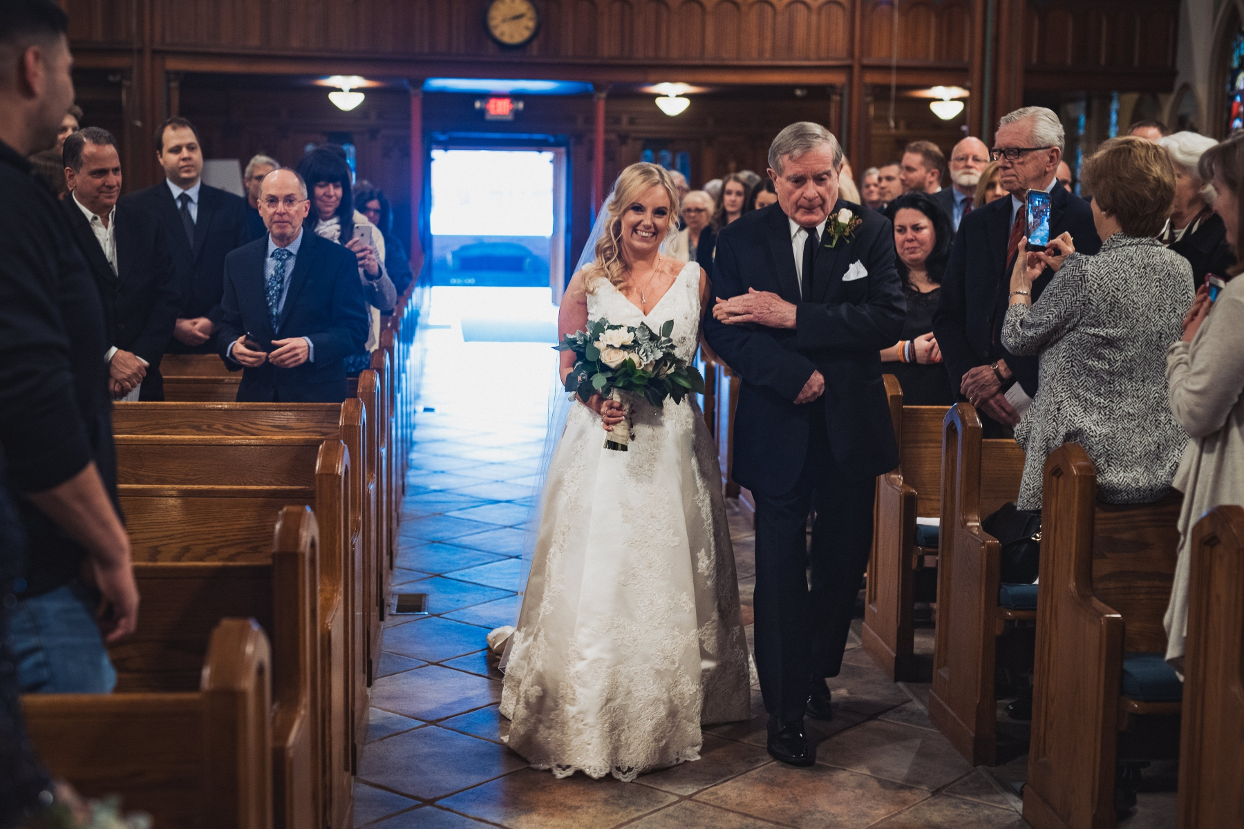 Tara's father walking her down the aisle for her New York wedding in Nyack.