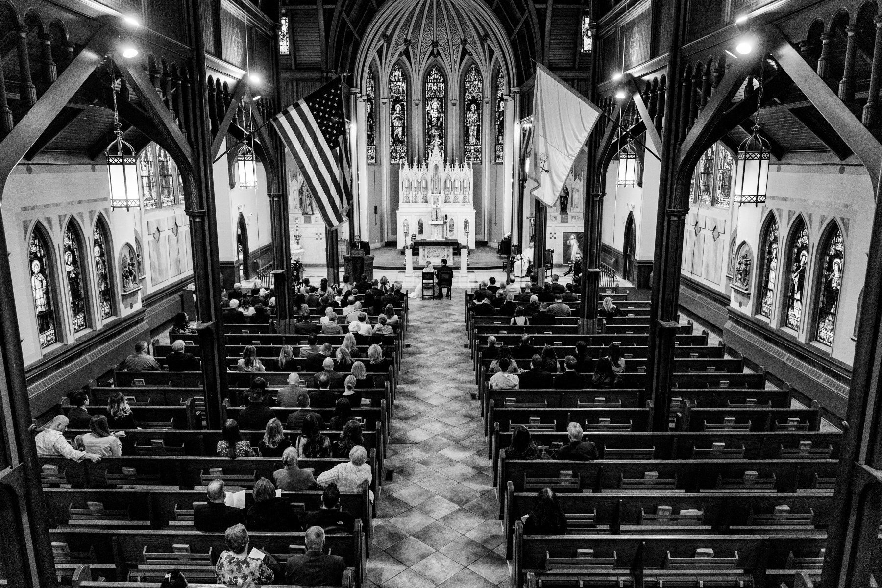 A wide shot of the ceremony shot from the balcony where the organist was playing.