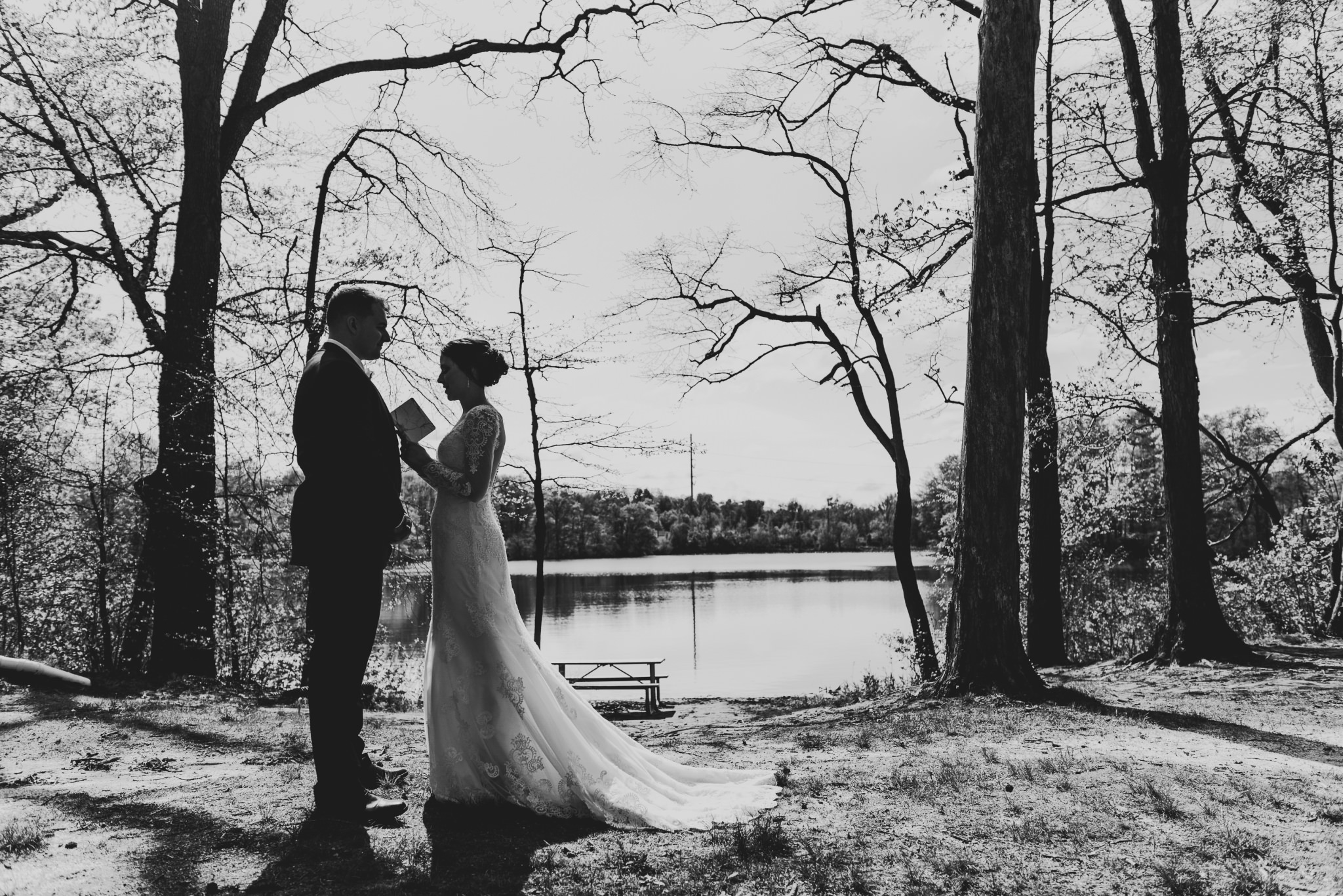 The theme of this wedding was definitely the amazing silhouettes. Here, Luke and Kelly are doing a private reading of their vows, just sharing a moment before their ceremony.