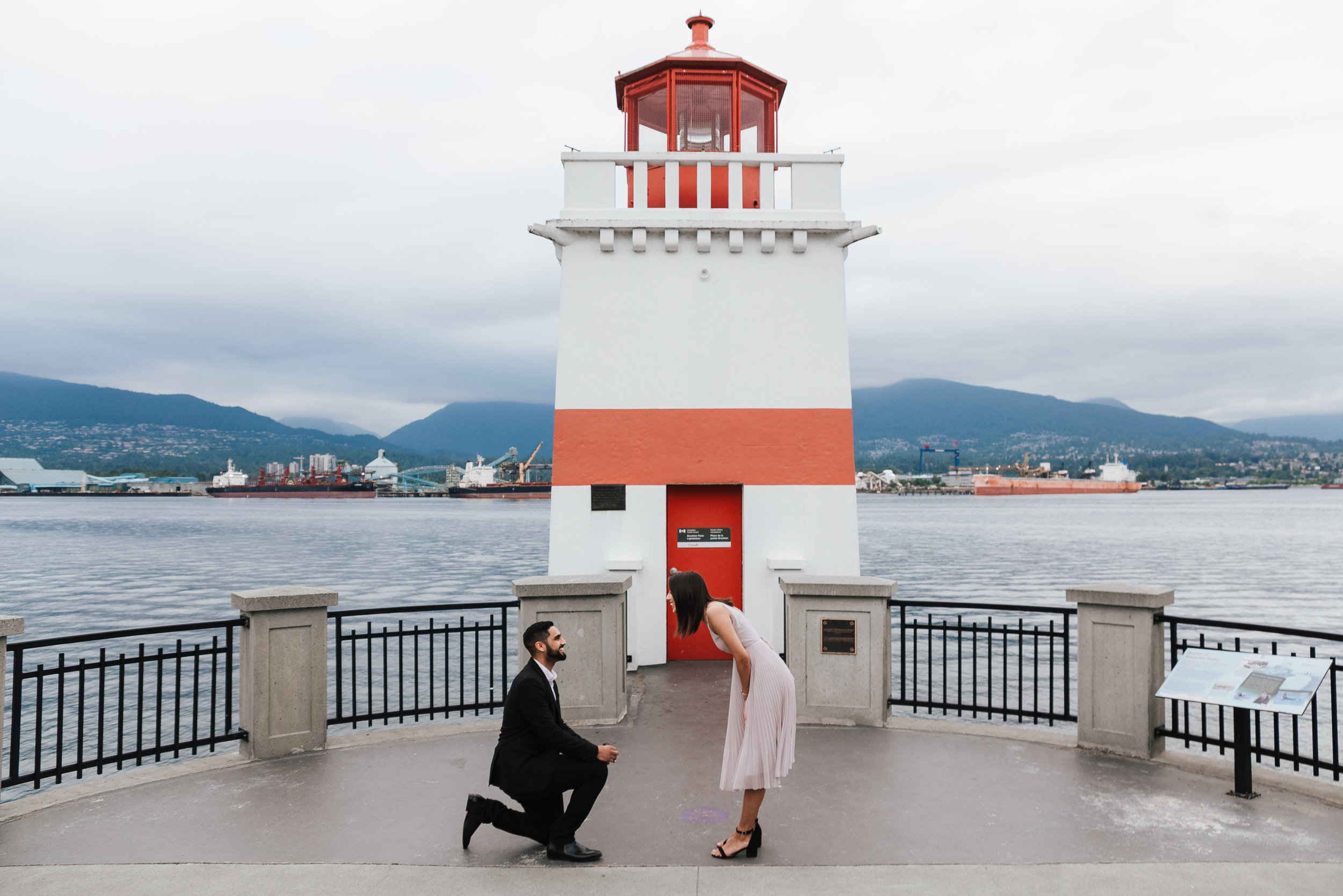 Boyfriend proposes to girlfriend at Brockton Point Lighthouse at Stanley Park.