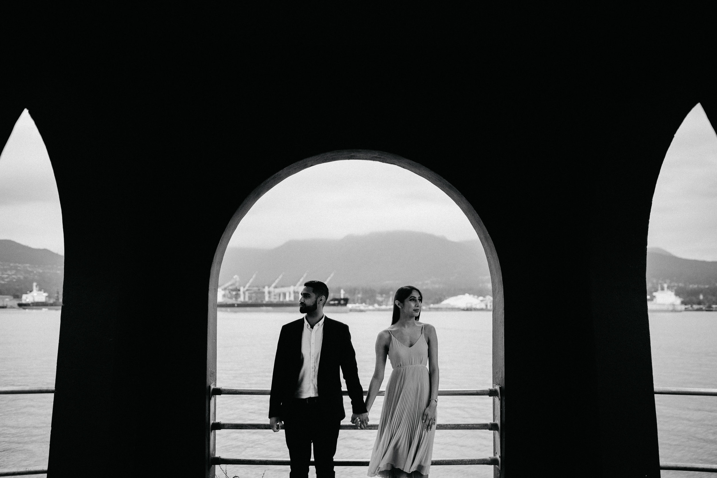 Engaged couple at Brockton Point Lighthouse in Stanley Park.