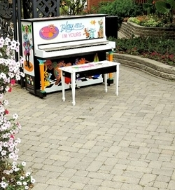 Colorful piano in a garden setting.....very beautiful
