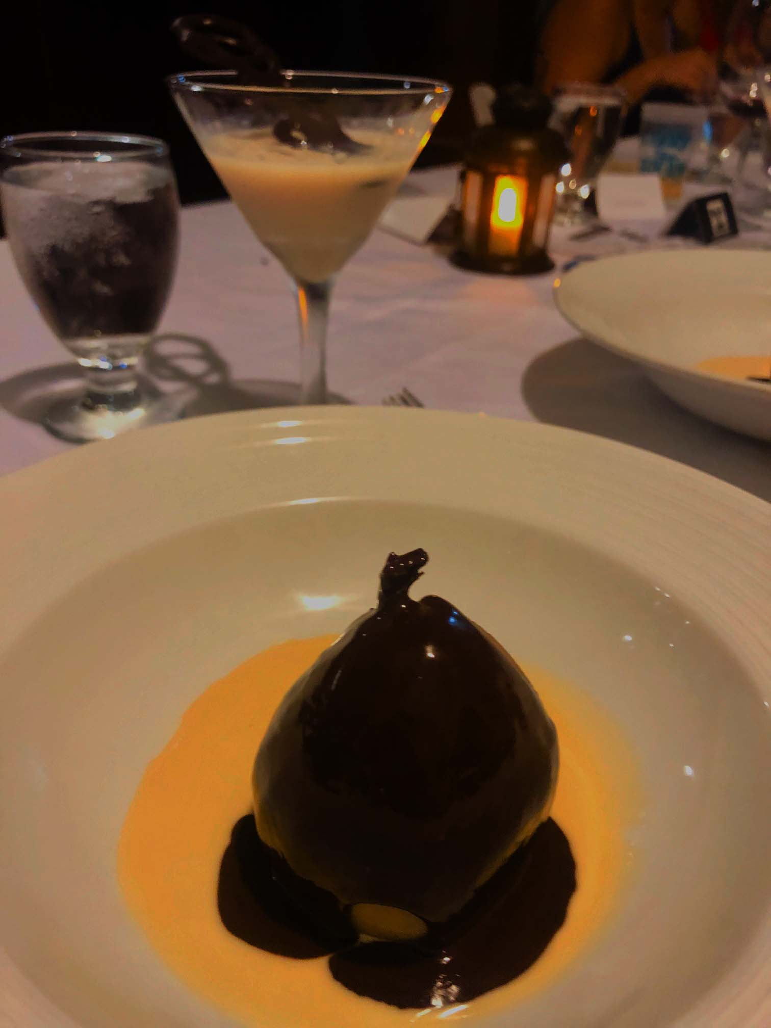 Vanilla poached pear with chocolate sauce and creme anglaise with white chocolate martini
