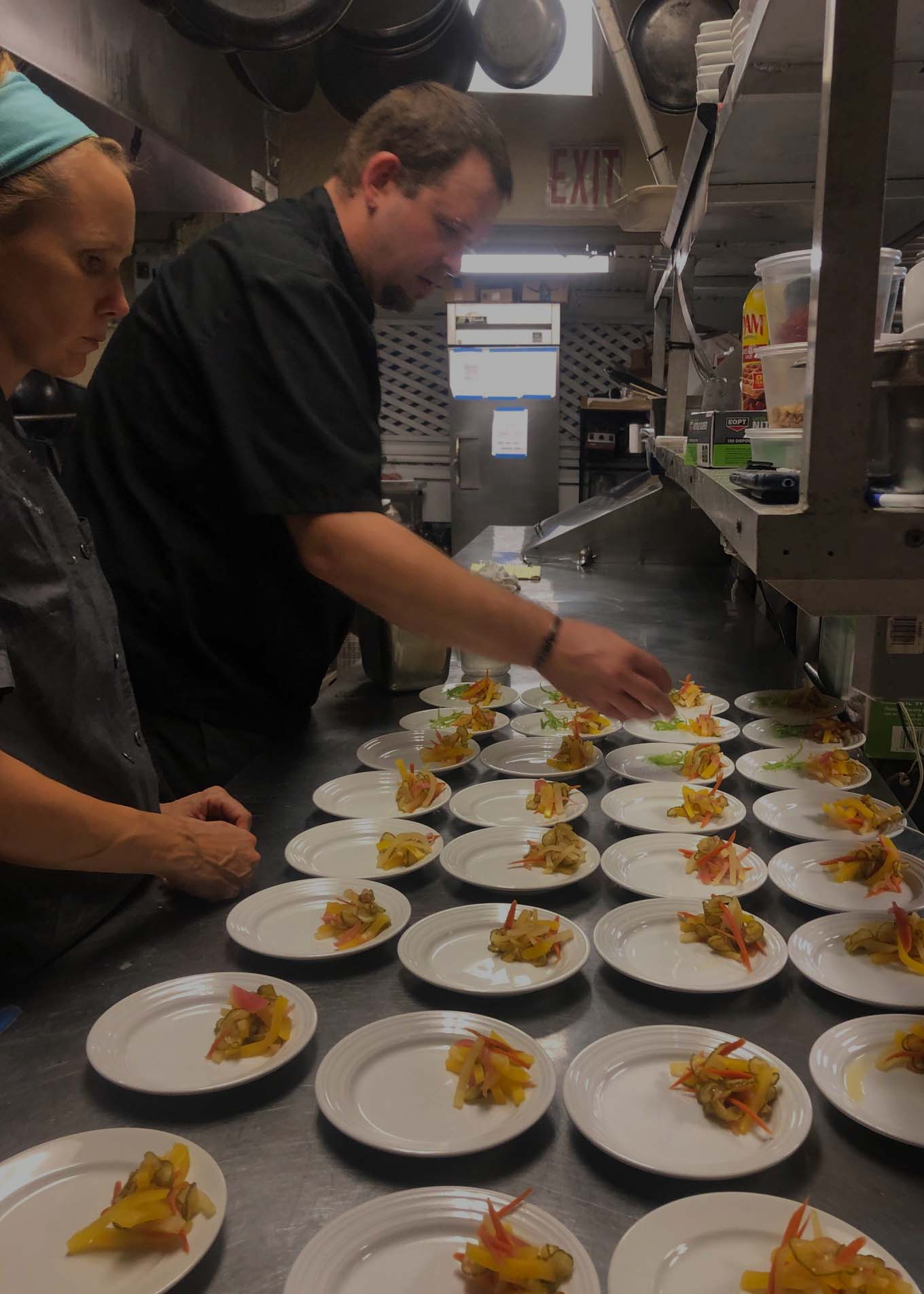 Chef Larry and Chef Lori working on the April Full Moon Dinner