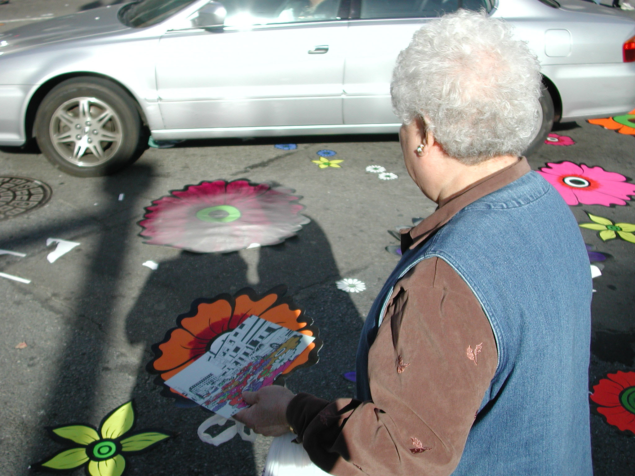 older woman holding flower & card.jpg