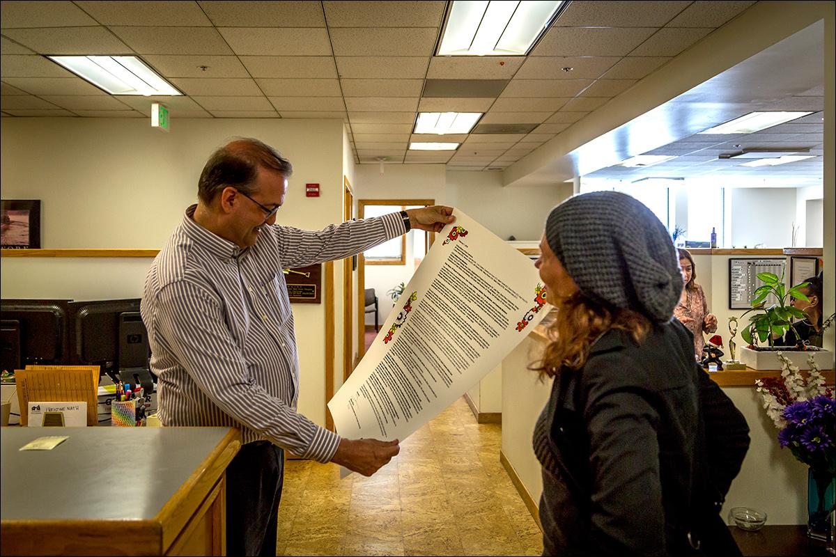 Delivering broadside letter to John Updike, Director of Real Estate, City and County of San Francisco